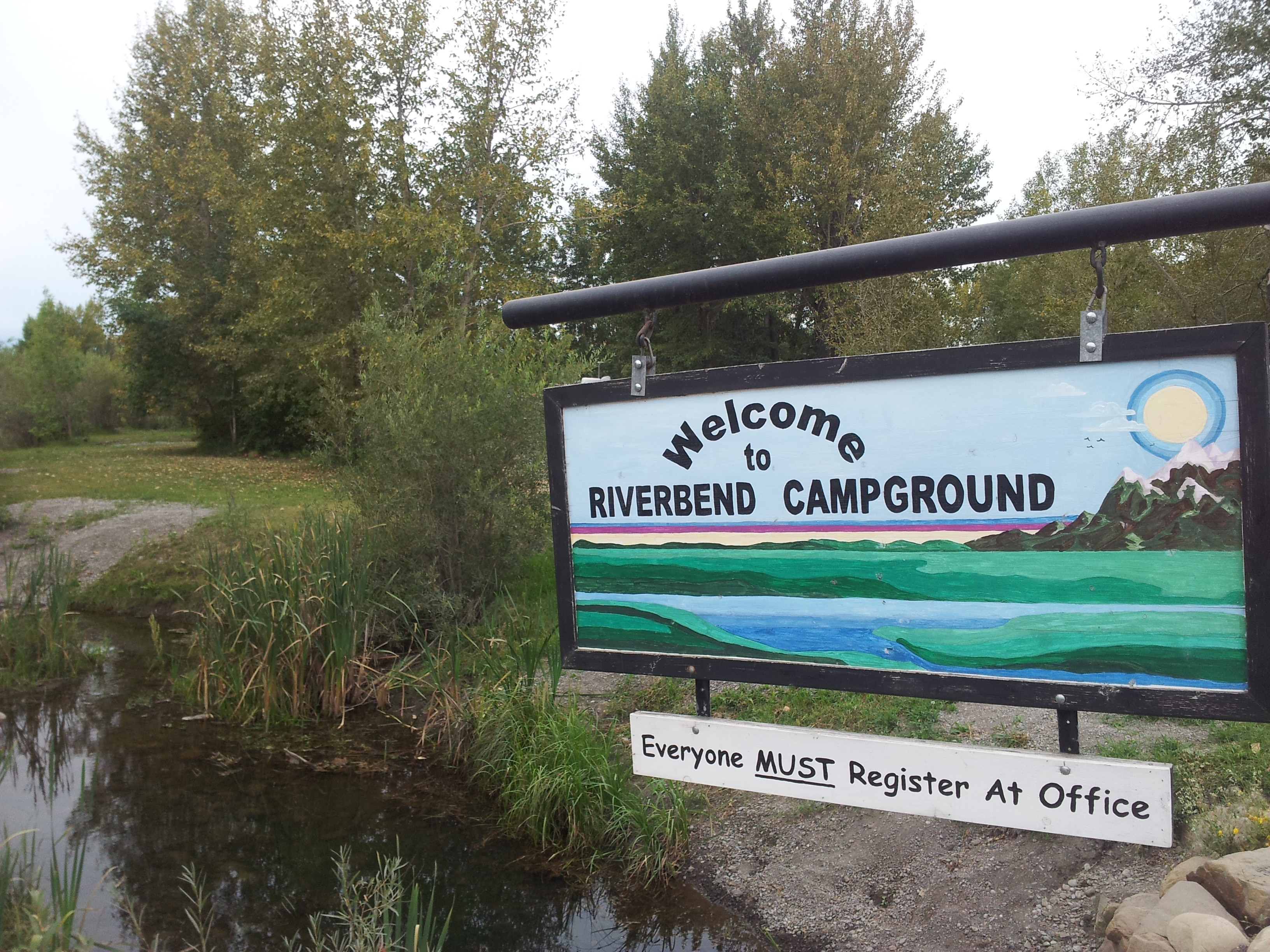 Welcome sign at entrance to Riverbend Campground, Okotoks, south of Calgary Alberta.