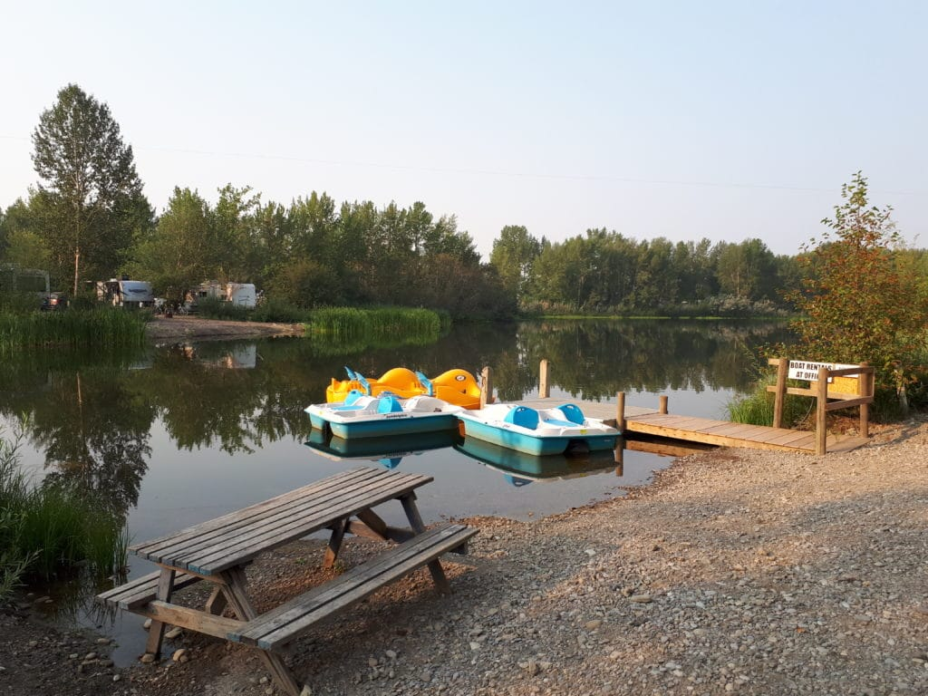 Paddle boats on pond at Riverbend Family Campground available for rent