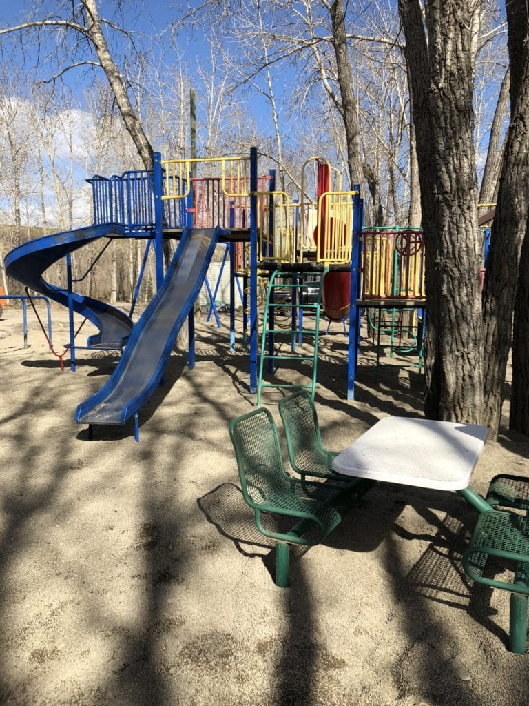 camping activities for kids include playground featuring climbing apparatus and slides