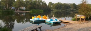 Paddle boats on pond at Riverbend Campground available for rent